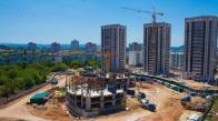 Строящийся в Городе «Крымская роза» жилой квартал «Фиалка», за ним – 17-этажные дома ЖК «Лаванда»